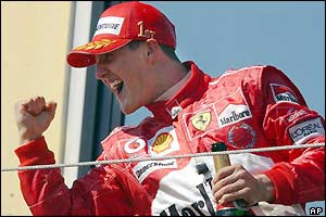 Michael Schumacher celebrates victory in the San Marino Grand Prix