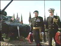 Wreaths being laid beside the Sherman tank
