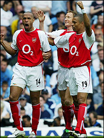Thierry Henry, Ray Parlour and Gilberto celebrate Patrick Vieira's goal in the north London derby between Arsenal and Spurs