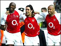 Arsenal's Patrick Vieira, Robert Pires and Thierry Henry celebrate