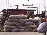 Members of the Nigerian army engage militants in a gun battle near the shores of Warri seaport in 2003