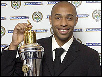 Thierry Henry celebrates with his Player of the Year trophy
