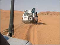 Four wheel drive vehicles on sand