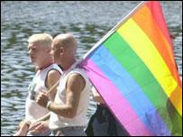 Gay men holding rainbow flag