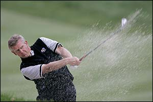 Montgomerie plays out of a bunker