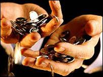 Coins falling through hands
