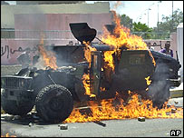 Burning US Humvee in Baghdad
