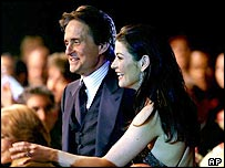 The couple receive an award for the 2001 film Traffic, in which they both starred