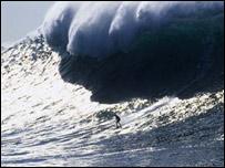 Surfer at Belharra Reef, south west France