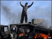 Iraqi in triumph on burning US Humvee