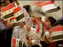 Iraqi children waving Iraqi flags