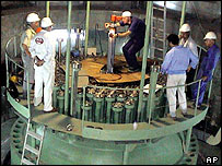 Technicians measure part of the reactor of Iran's Bushehr nuclear power plant