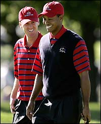 Chris Riley and Tiger Woods are all smiles as they beat Ian Poulter and Darren Clarke in the fourball