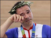 Britain's Darren Kenny wipes away a tear after receiving his cycling gold medal