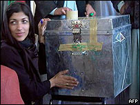 Afghan woman with ballot box
