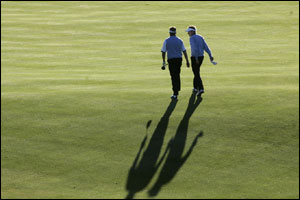 Darren Clarke and Ian Poulter head down the fairway
