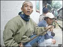 Muslim militant holding a sword