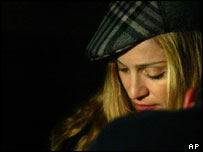 Madonna prays inside the tomb of Kabbalist Rabbi Yehuda Ashlag during a visit in the Givat Shaul cemetery in Jerusalem