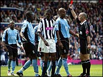 Fulham's Papa Bouba Diop (second left) is shown the red card by referee Mike Dean