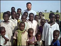 Jesse Jackson Jr with children at the Kalma camp