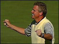 Colin Montgomerie celebrates sinking the winning putt