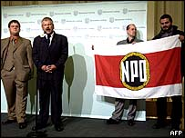 Holger Apfel (L), top NPD candidate, and Uwe Voigt (2nd L), leader of the NPD speak to reporters in Dresden.