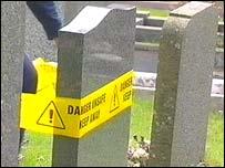Gravestone with warning tape