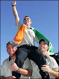 Darren Clark (left) and Padraig Harrington (right) lift Paul McGinley