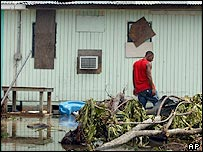 An islander surveys the devastation left by Hurricane Ivan
