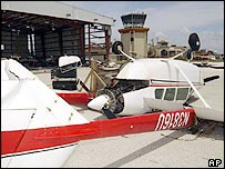 An overturned plane at Grand Cayman international airport