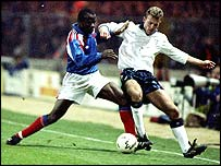 Basile Boli of France tackles England's Alan Shearer during a friendly in 1992