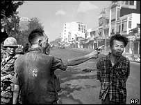 South Vietnamese Police Chief Nguyen Ngoc Loan executes a Vietcong officer with a single shot in the head in Saigon