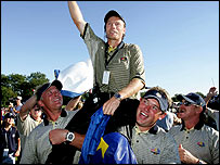 Bernhard Langer is hoisted onto his players' shoulders