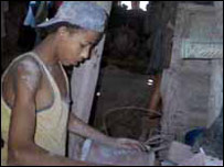 Boy at work in local pottery factory