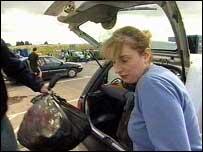Mandy Gregory empties her rubbish