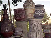 Pots made in Reda's factory are stacked up to go on sale