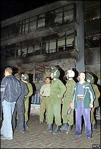 Emergency services outside the damaged former UN building
