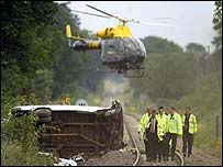 A minibus and train collided in July 2003