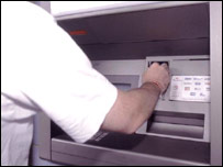 A person using a cash machine
