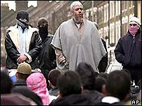 Abu Hamza preaches outside the Finsbury Park mosque after being barred from it in 2003