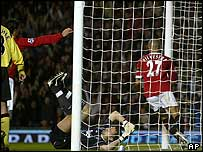 Mikael Silvestre (right) turns away after scoring Manchester United's first goal