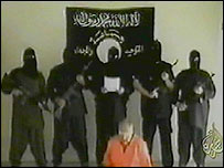 A still from Al-Jazeera's broadcast of a video purportedly showing the killing of a US hostage