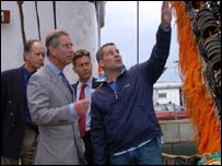 Prince Charles examines fishing net - PA