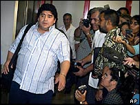 Diego Maradona (left) arrives t Cuba