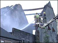 Firefighters spray building