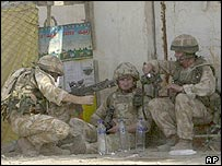 British troops relaxing in a Basra street on Friday