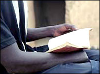 An amputee reading the Qur'an