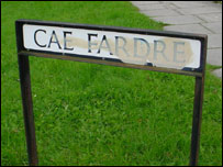A vandalised street sign on the estate