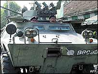 Thai security officers in an armoured car patrol the streets in Pattani province