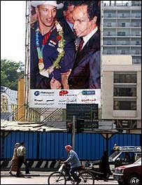 Cairo billboard showing Hosni Mubarak's son Gamal with an Egyptian gold medallist